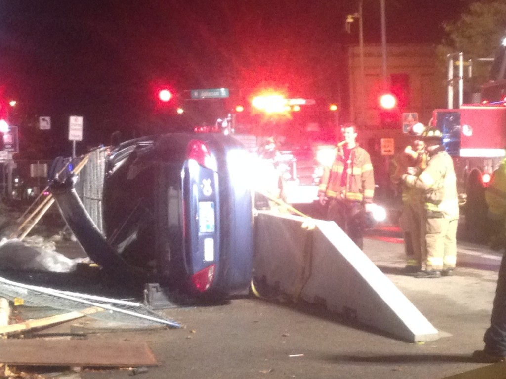 Madison fire cut passengers out in downtown roll over