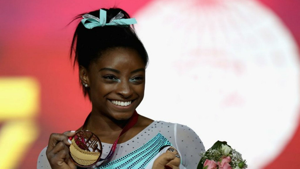 Brother of Olympic gymnast Simone Biles charged in triple slaying