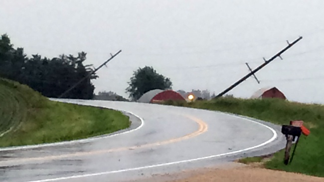 PHOTOS: Crews work to clean up damage from Monday storms