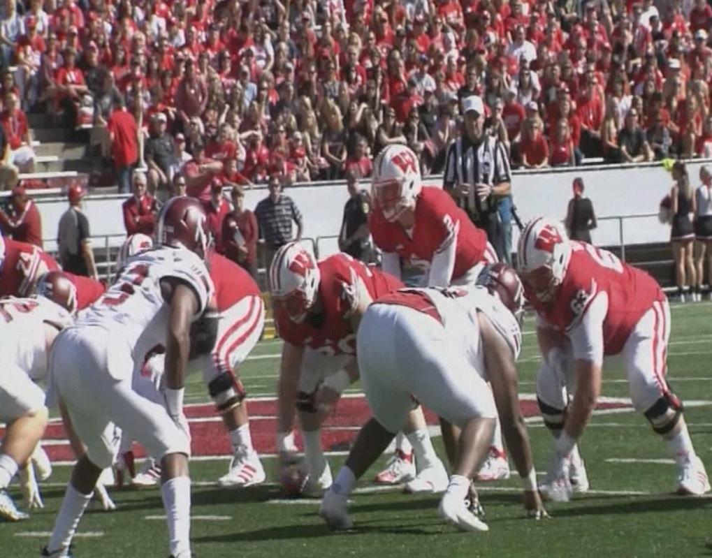 Ejections, fire alarm, but No. 24 Wisconsin beats Troy 28-3