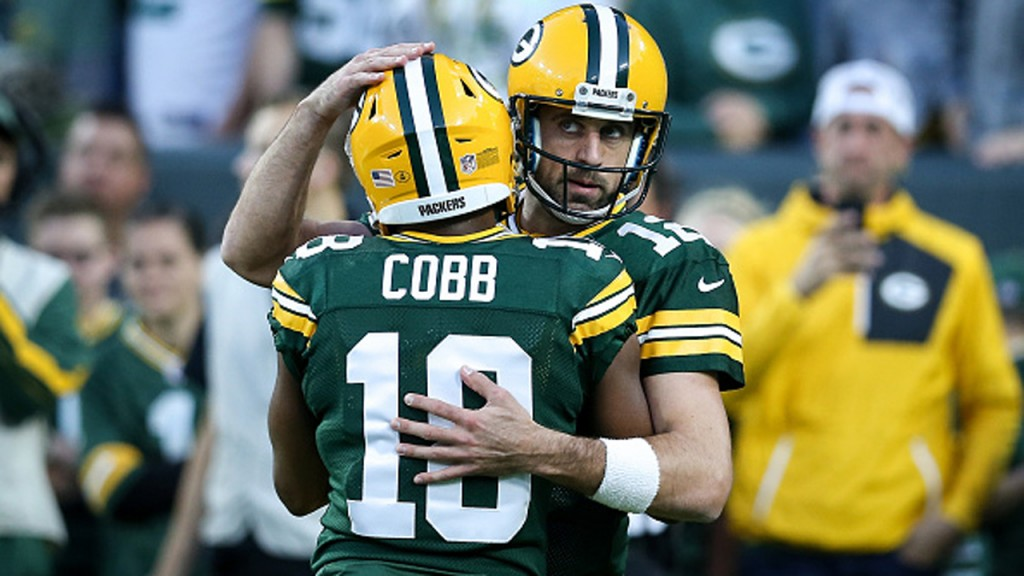PHOTOS: Cobb, Rodgers' gametime hugs over the years