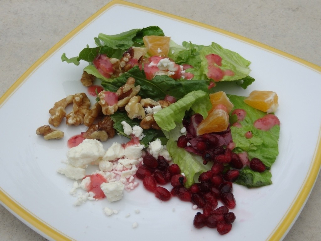 Donna's salad with walnuts, feta, pomegranate with cranberry vinaigrette