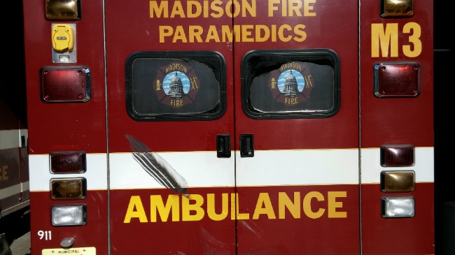 Van accelerates into ambulance as crews try to rescue unresponsive driver