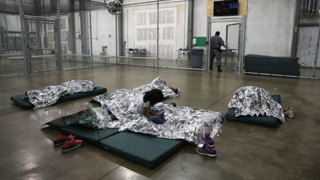 Videos under review show staffers pushing, shoving migrant kids