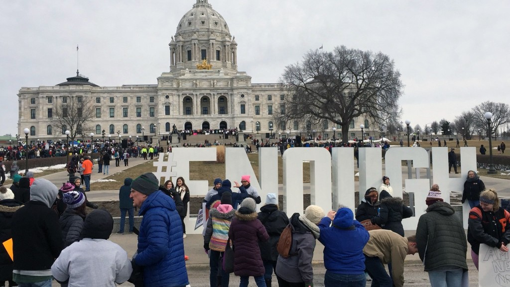 There's a large ENOUGH sign outside the capitol in Minnesota