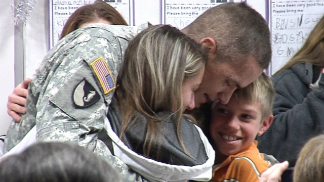 Sgt. surprises kids with secret homecoming