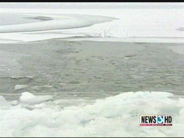 Boy rescued after falling through ice in Minocqua