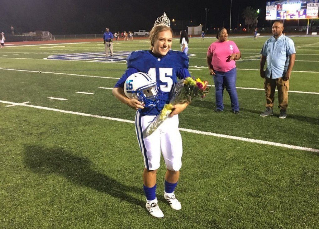 She traded the homecoming crown for a football