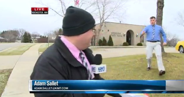 WATCH: Bank robbery suspect runs past bank during live news shot