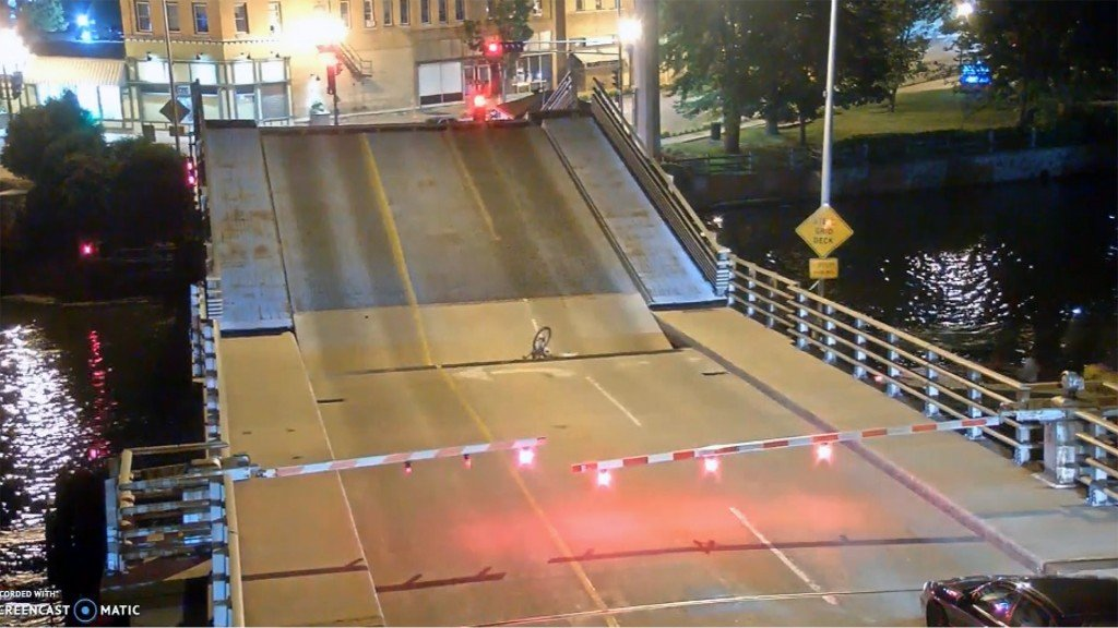 Bicyclist ignores stop arms, falls into drawbridge's gap