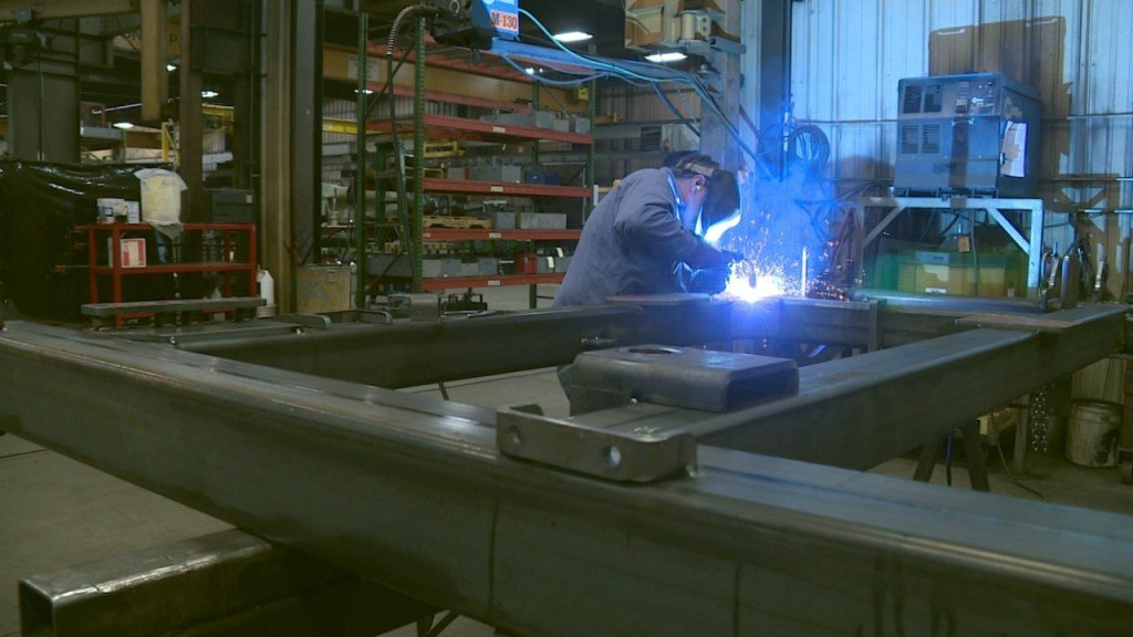 McFarlane employees craft patriotic message out of steel