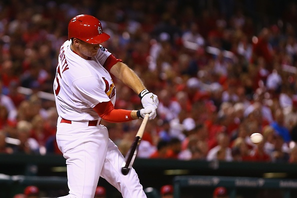 Cardinals get two runs late to beat Reds 2-1
