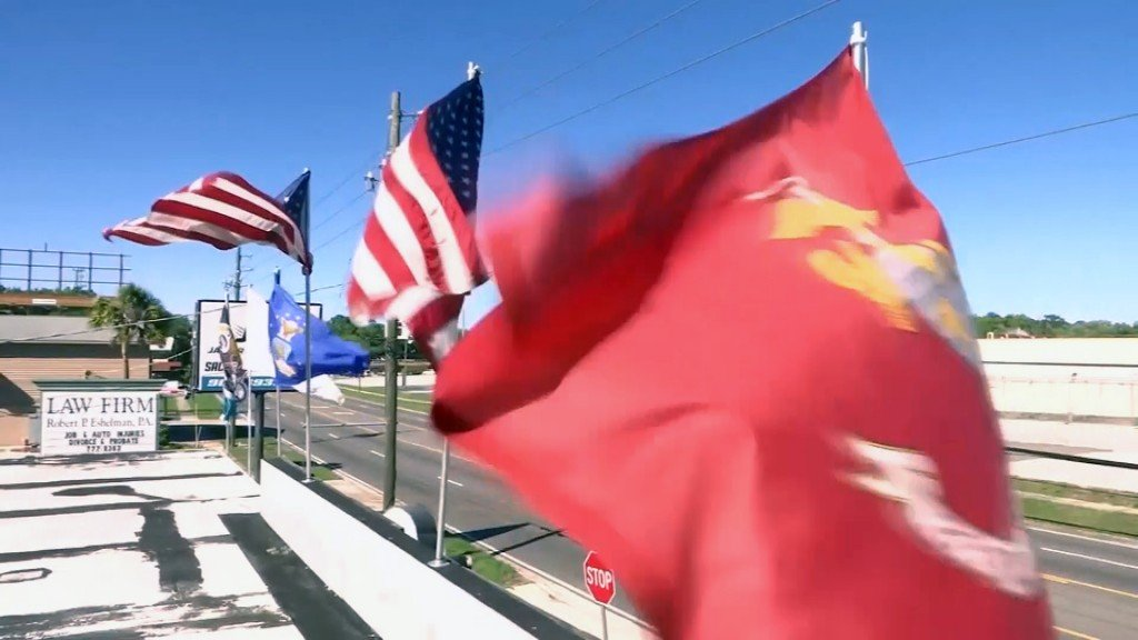 Florida city suspends inspector over flag flap