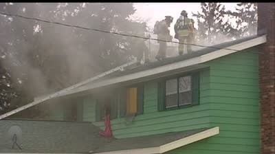 Firefighters rescue teens from burning home