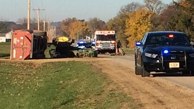 Tractor driver ejected in crash with truck, suffers possible wrist injury