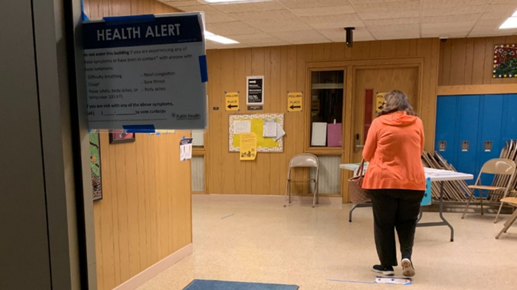 A Health Alert is seen posted April 7, 2020, at a Madison polling location