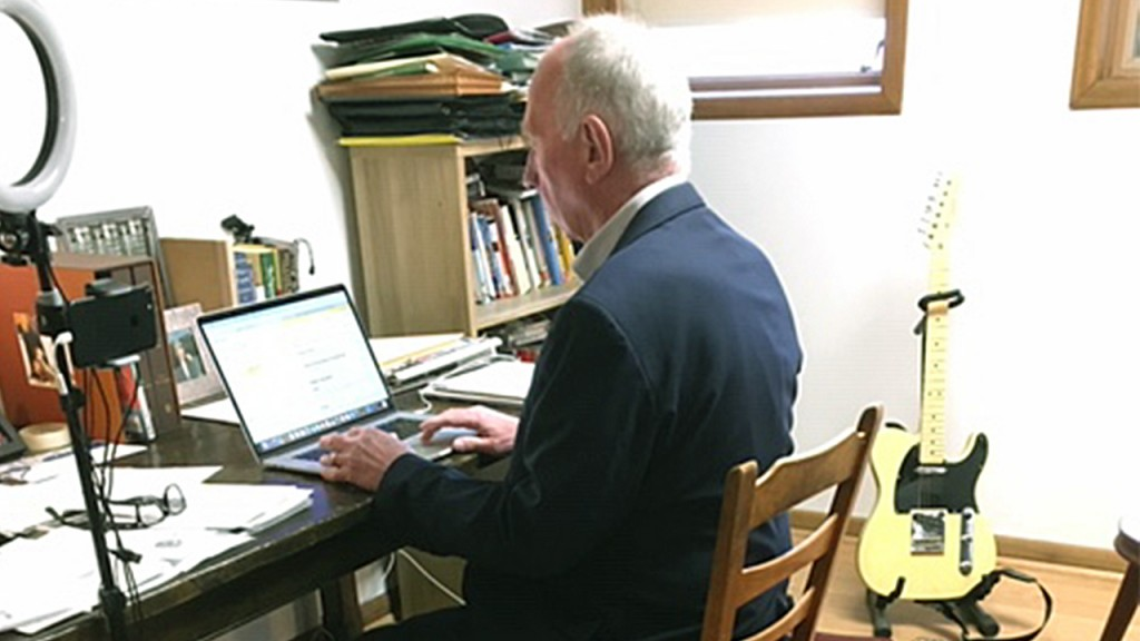 Neil Heinen sitting at his home office