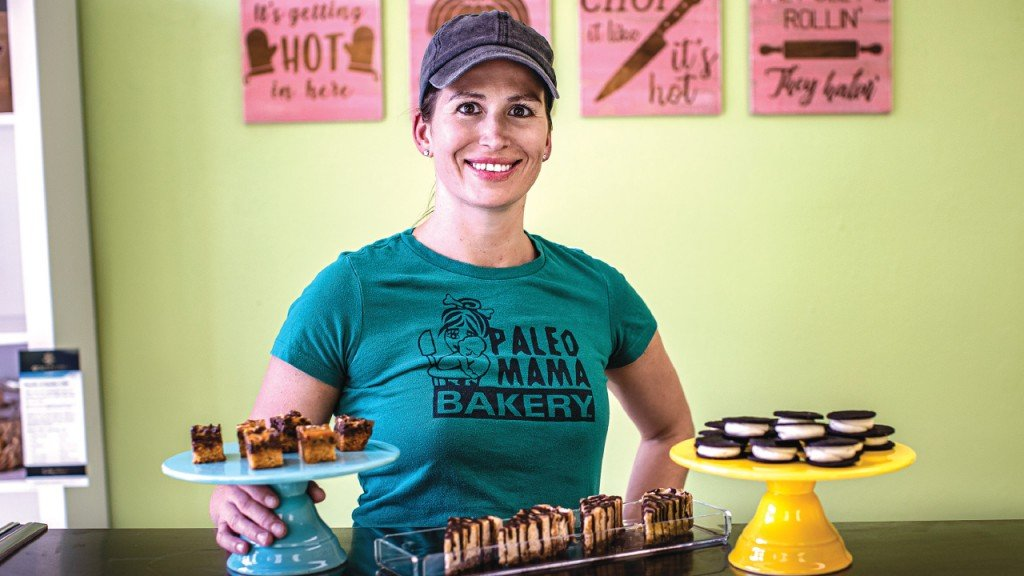 Belle Pleva in front of items at Paleo Mama