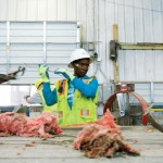 worker looking at the trash