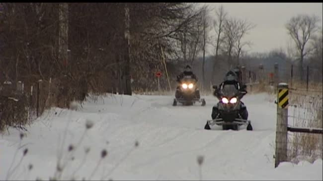 Snowmobiles hit open water; 2 suspected of OWI