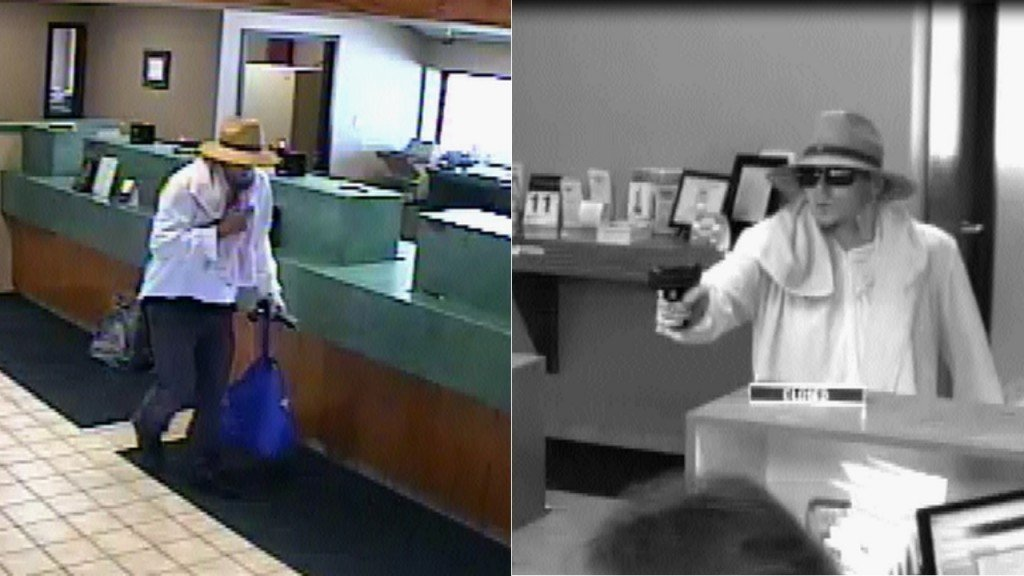 Suspected fedora-hat-wearing bank robber faces 22 new charges in Dodge County