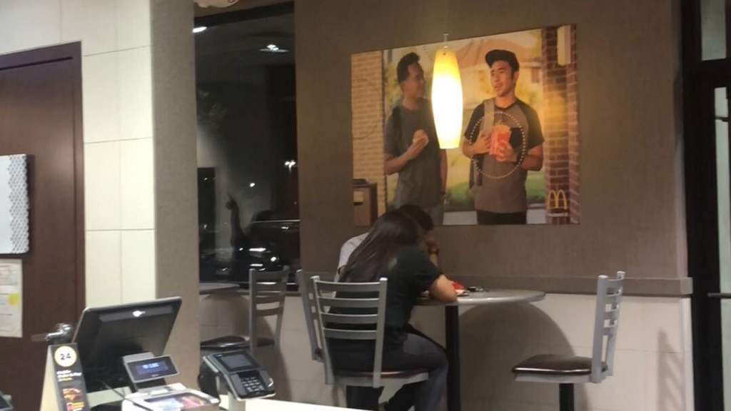 2 guys hung up a poster of themselves at McDonald's