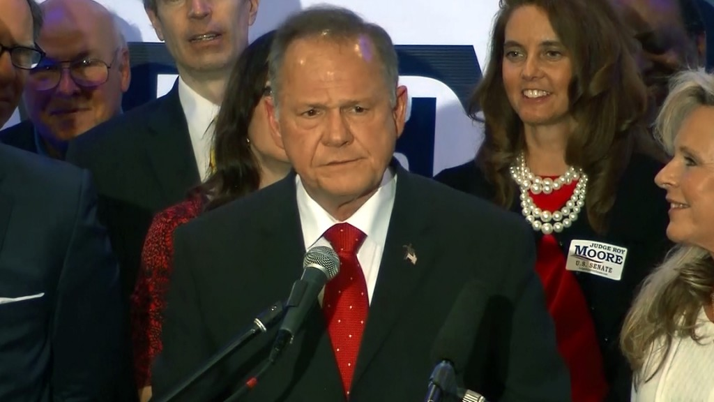 Roy Moore church event interrupted by protester, comedian