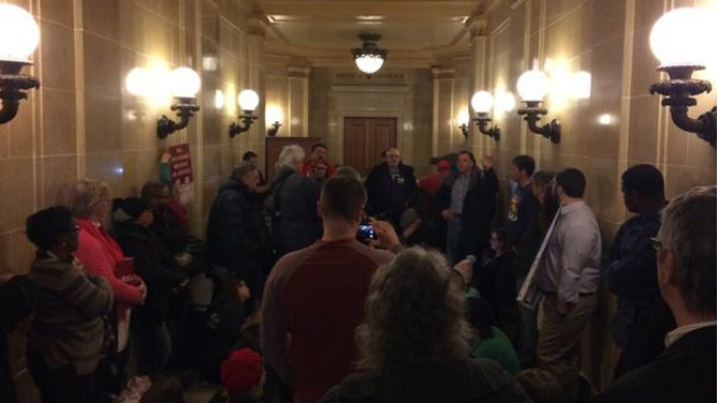 Protesters gather at Walker's office opposing right to work