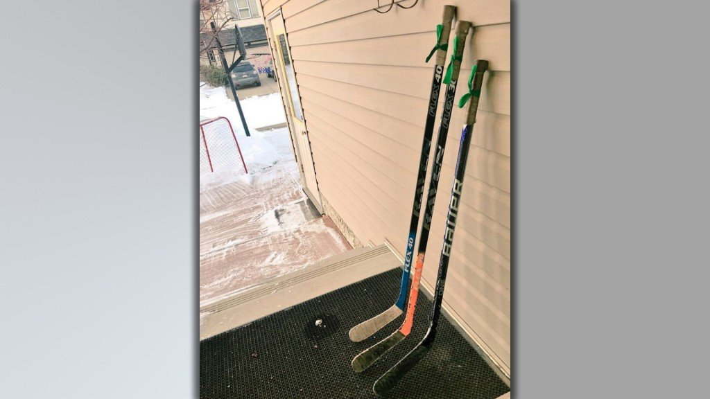 After a devastating bus crash, mourners are paying tribute with hockey sticks