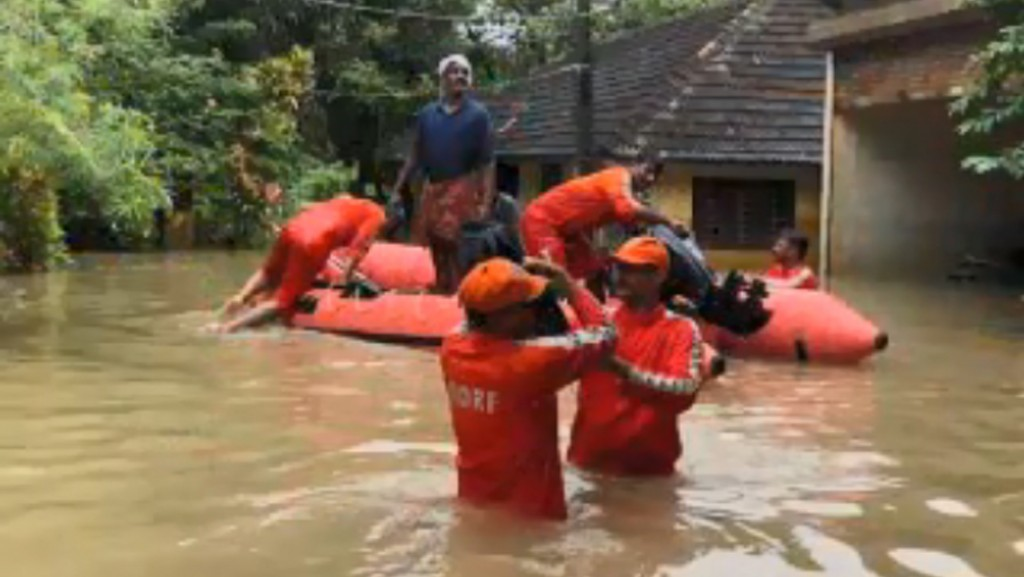 Rescue teams wade through filthy waters to help Kerala flood victims