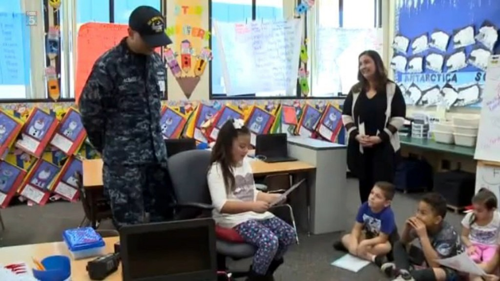 Military dad surprises daughters after being away for a year