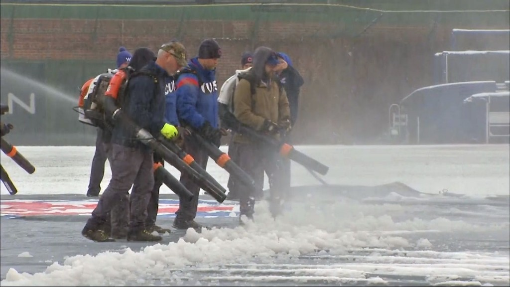 Snow-covered Wrigley Field delays Cubs opener