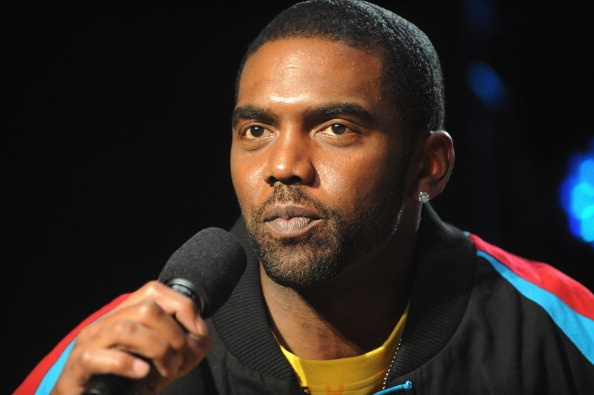 Randy Moss hands diploma to longtime young friend