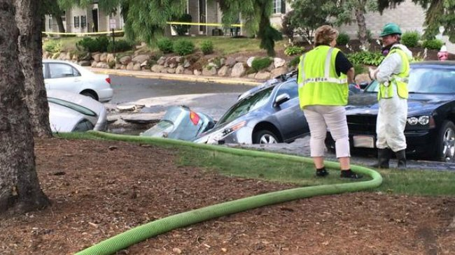 PHOTOS: Residents evacuated after 3 cars fall in sinkhole