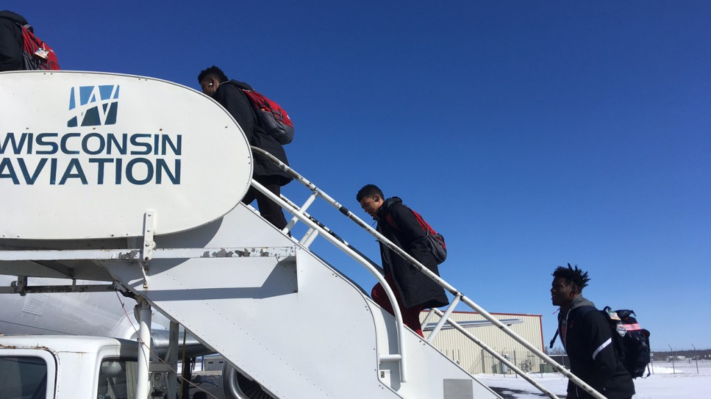 PHOTOS: Badgers get on plane to NCAA tournament