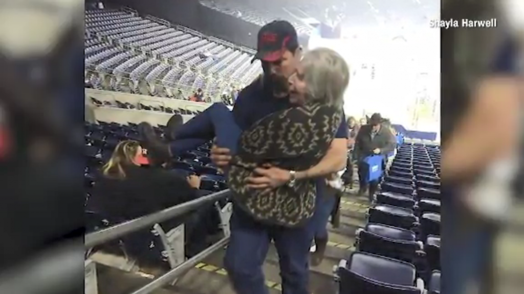Photo of firefighter carrying elderly woman up stairs captures hearts