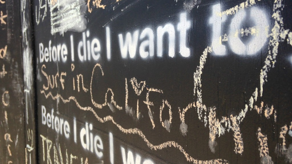 PHOTOS: 'Before I die' chalkboard invites passersby to share aspirations