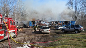 Body of 5-year-old found in Holcombe fire