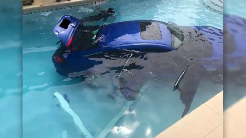 Woman's car rolls into pool after she forgets to put it in park