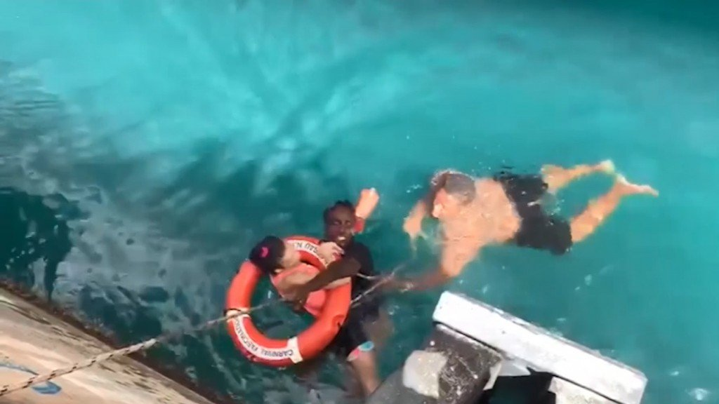 2 men rescue wheelchair-bound woman who fell off dock