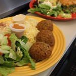 Falafel Spanikopita on a yellow plate served with salad.