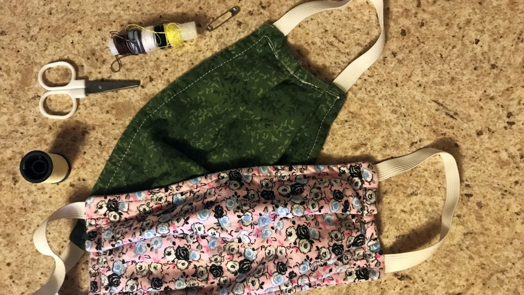 two Handmade Cloth Masks With Sewing Supplies