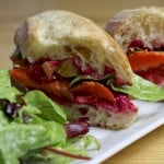Roasted vegetable sandwich on a plate.