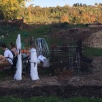 Two students sit at the Eagle Heights Community Garden.