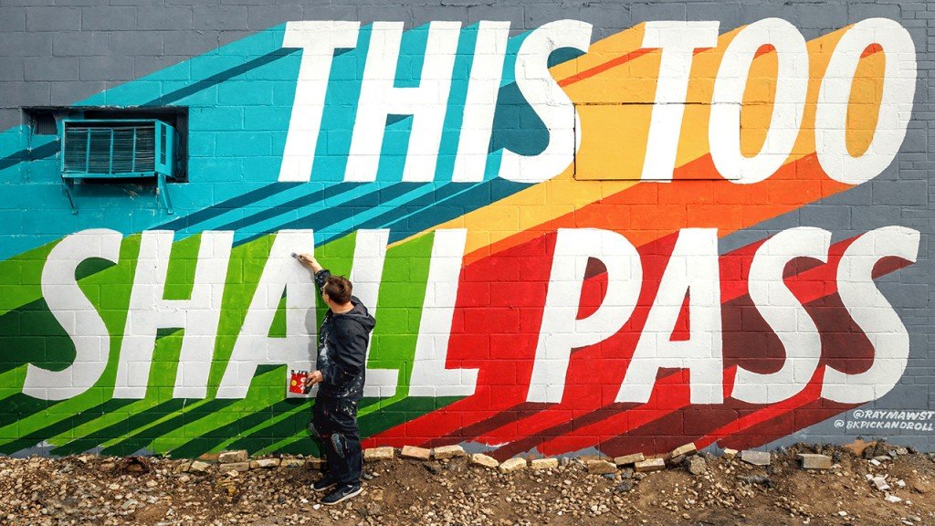 "Ray Mawst painting a mural that says ""This Too Shall Pass"""