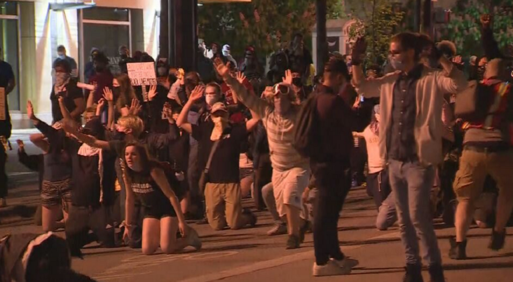 Protesters at a Sunday demonstration past curfew
