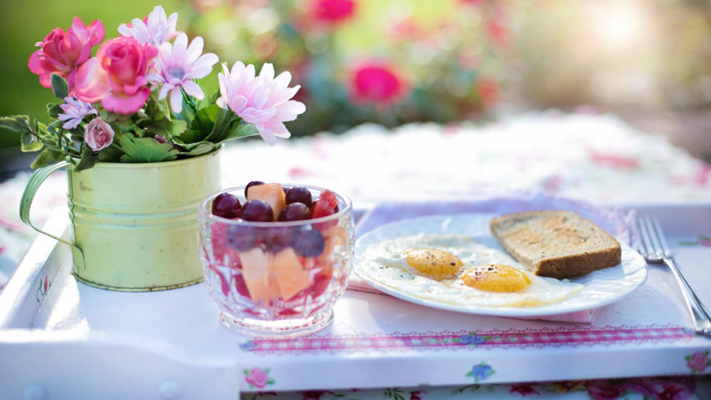 Eggs and fruit on a platter with flowers