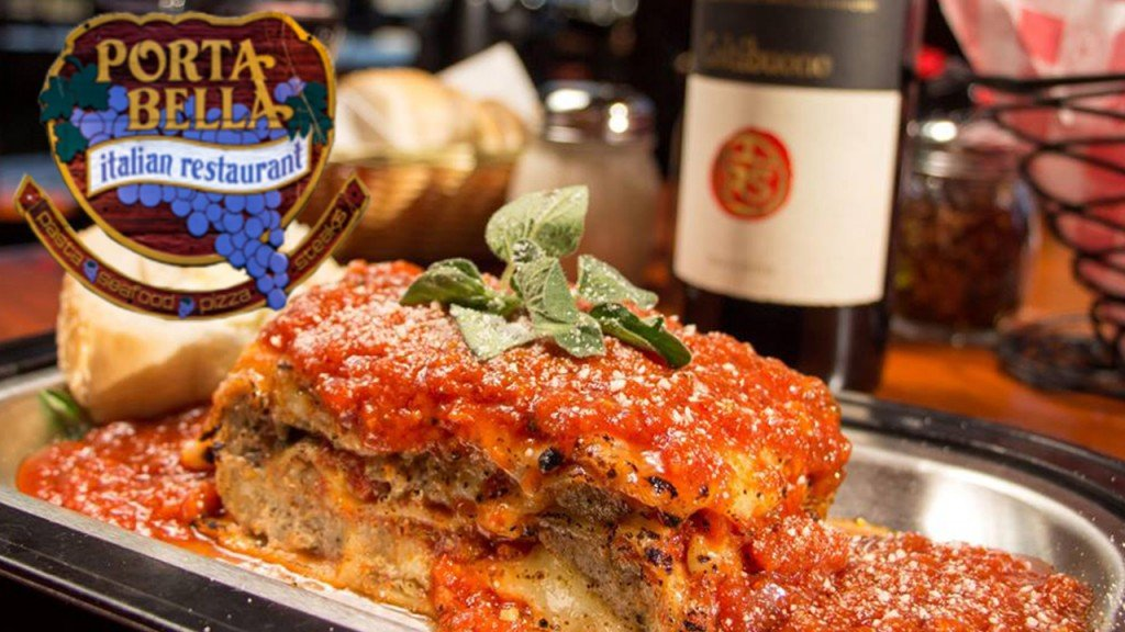 Porta Bella's lasagna with a bottle of wine