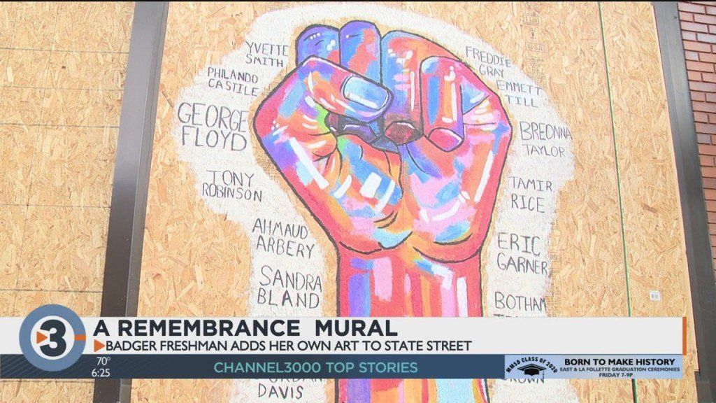Looking At A Remembrance Mural On State Street