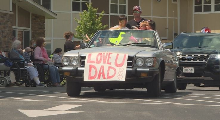 "car drives past home residents with sign, reads ""love u dad"""